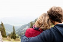Man hugging woman, they watching landscape — Stock Photo