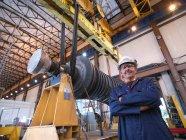 Engineer With Turbine And Crane — Stock Photo