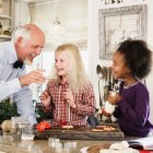Family baking Christmas cookies together — Stock Photo