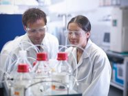Scientists looking at protein samples, readying for mass spectrometry in biolab — Stock Photo