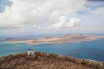 Two women overlooking tropical islands — Stock Photo