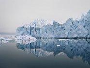 Glacier reflected in still lake — Stock Photo