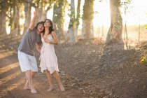 Couple walking together on dirt road — Stock Photo