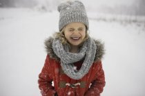 Happy young girl walking in snow — Stock Photo