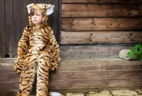 Boy wearing tiger costume outdoors — Stock Photo