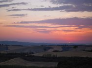 Sun rising over rural landscape — Stock Photo