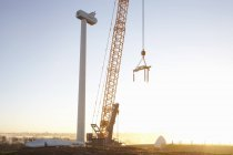 Wind turbine being erected at sunset — Stock Photo