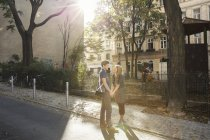 Young couple face to face on suburban street — Stock Photo