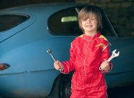 Boy wearing race car driver costume — Stock Photo