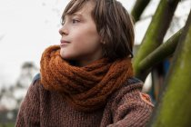 Boy in scarf looking away — Stock Photo