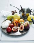 Selection of fruit and meringues served on table — Stock Photo