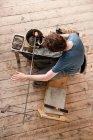 Glassblower shaping hot glass — Stock Photo