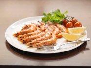 Plate of prawns at restaurant — Stock Photo