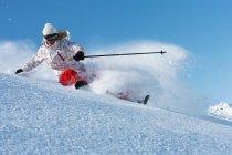 Skier on snowy slope — Stock Photo