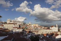 View across Alfama to Paroquia de Sao Vicente de Fora, on left with the Dome of the National Pantheon on right , Lisbon, Portugal — Stock Photo