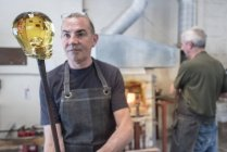 Glassblower with large blob of hot glass — Stock Photo