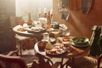 Antipasto starters with beer and wine on tables — Stock Photo