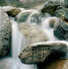 Waterfall flowing over boulders — Stock Photo