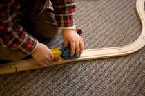 Young boy playing with train set — Stock Photo