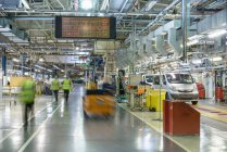 Car production line in car factory, blurred motion — Stock Photo