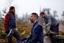 Male hikers relaxing on travel, Lapland, Finland — Stock Photo