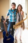 Kinder mit Musikinstrumenten — Stockfoto