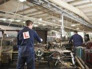 Apprentice & Engineer Working On Machine — Stock Photo