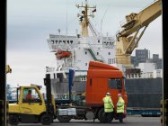 Port Workers With Lorry and Ship — Stock Photo