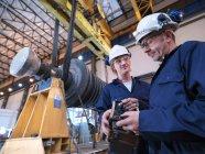 Engineers With Turbine And Crane — Stock Photo