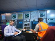 Air traffic controllers in radar room — Stock Photo