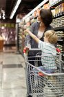 Woman grocery shopping with son, selective focus — Stock Photo