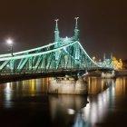 Illuminated Liberty Bridge at night — Stock Photo