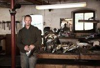 Blacksmith with armor in shop, selective focus — Stock Photo