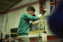 Boxer practising in boxing ring — Stock Photo
