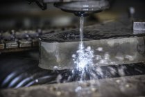 Sparks from wire erosion machine in factory — Stock Photo
