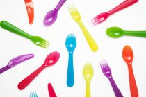 Colourful plastic knives, forks, spoons — Stock Photo
