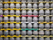 Stacked beer barrels in brewery, full frame — Stock Photo