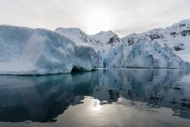Low clouds over Icebergs at Lemaire channel, Antarctica — Stock Photo