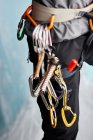 Cropped close up of carabiners on climbers harness — Stock Photo