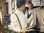 Father teaching son in family tailors shop — Stock Photo