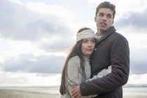 Young couple hugging, Brean Sands, Somerset, England — Stock Photo