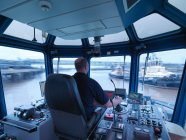 Captain steering tug out at sea, view of ships bridge and view through window — Stock Photo
