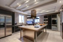 Interior of Luxury hi-tech style kitchen in wealthy home — Stock Photo