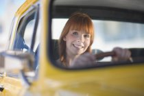 Portrait of smiling Woman driving a car — Stock Photo