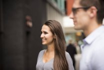 Young businessman and woman on street, London, UK — Stock Photo