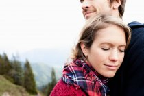 Couple cuddling at mountains — Stock Photo