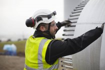 Engineer working on wind turbine construction site — Stock Photo