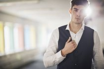 Portrait of man wearing waist coat looking at camera — Stock Photo