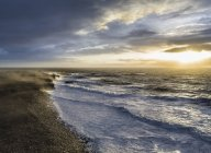 View of stormy sky and sea at sunrise — Stock Photo