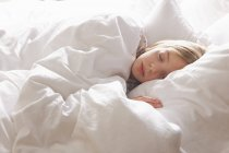 Blond haired girl asleep in bed — Stock Photo